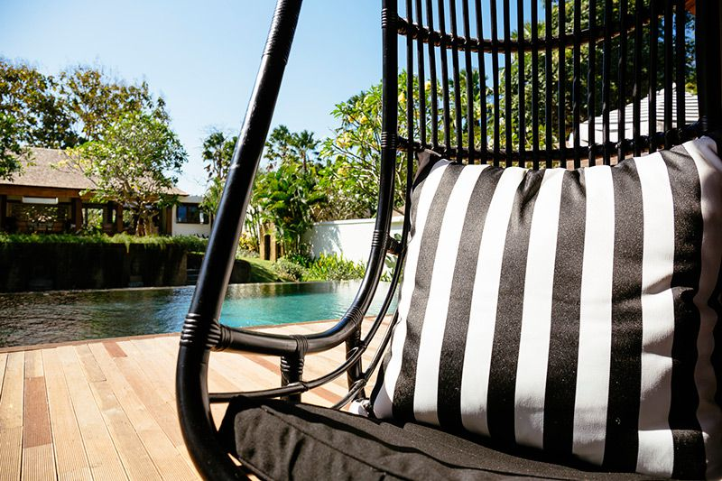 Simona-Oasis-and-Spa-Poolside-hanging-chairs
